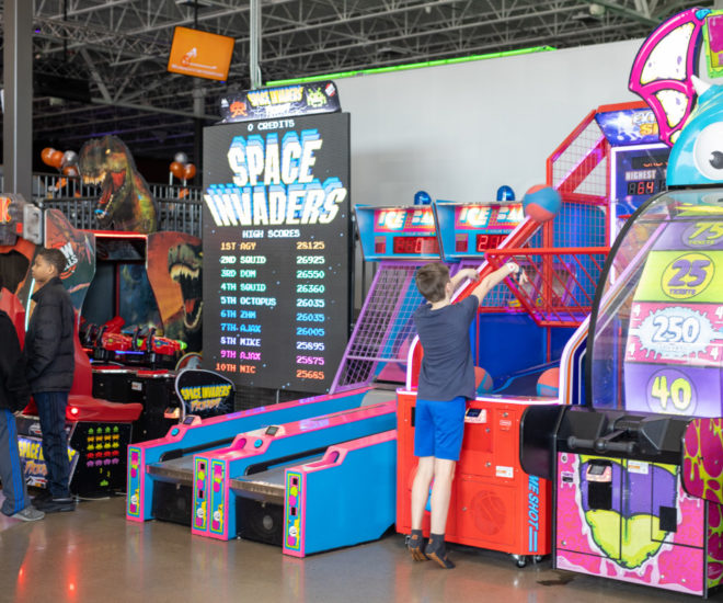 Decorative Photo of mall patron enjoying an arcade game
